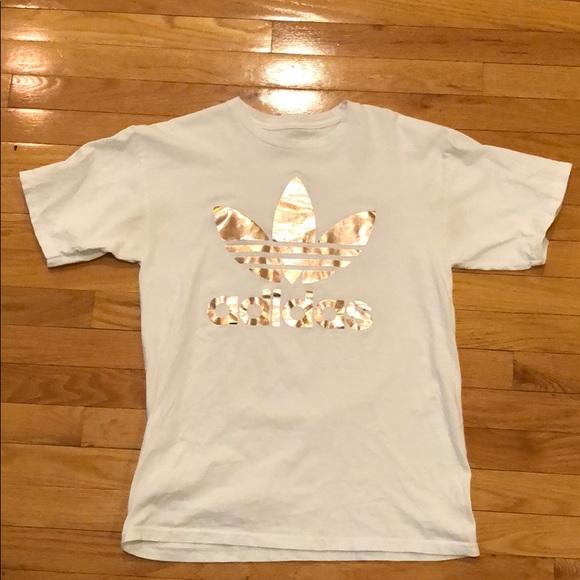 white adidas shirt with gold logo